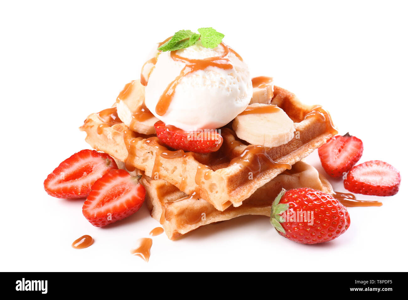 Delicious waffles with fruits and ice cream on white background - Stock Image