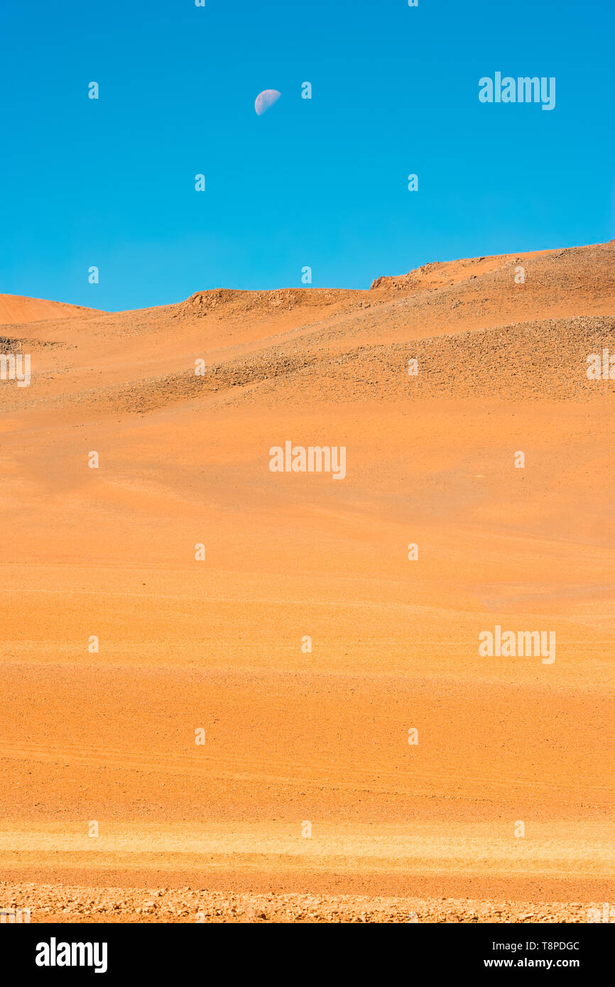 Moon over the Altiplano (high Andean plateau), Atacama desert, Chile, South America - Stock Image