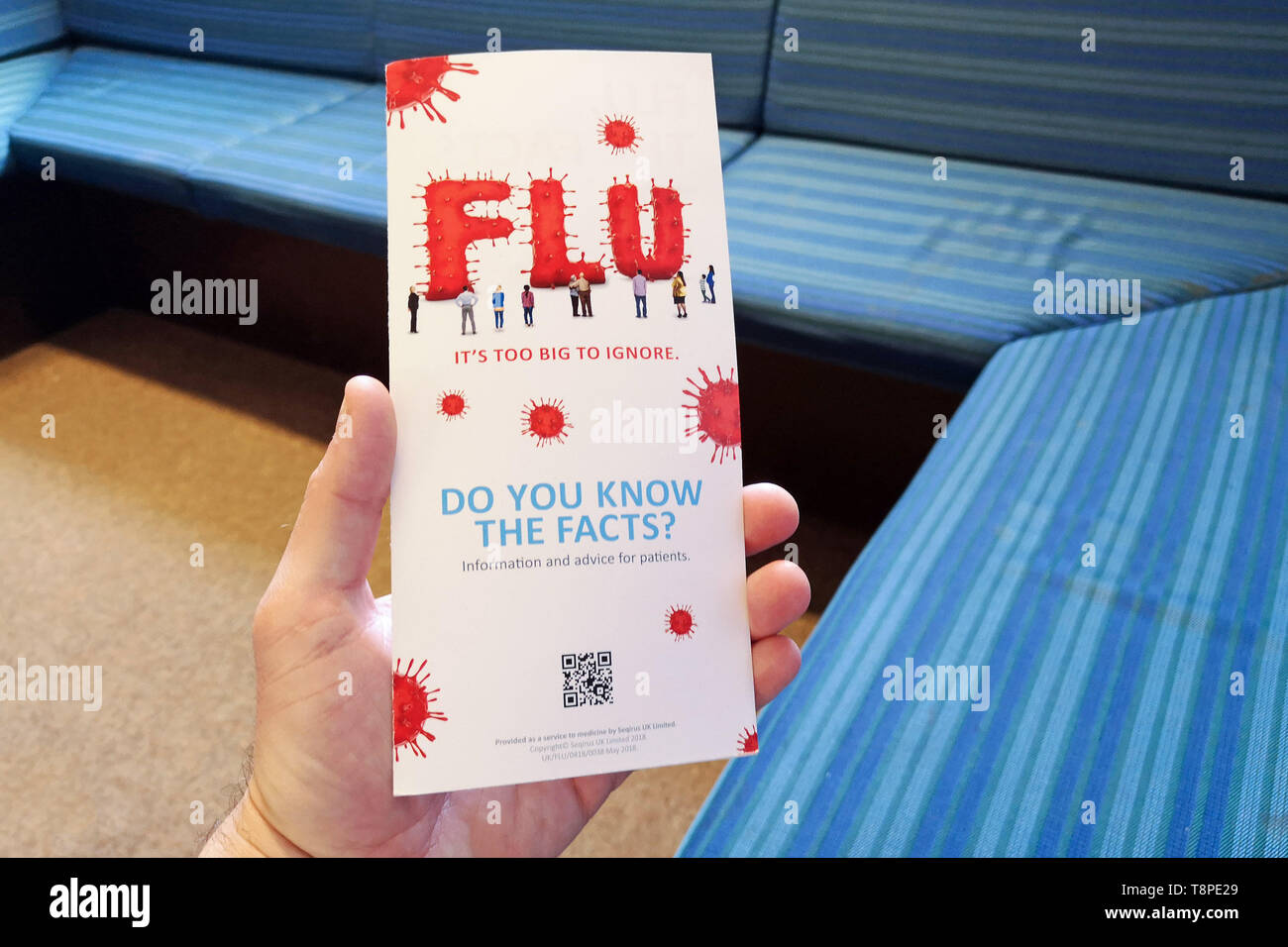 A leaflet with advice for patients about Flu is seen in an NHS local doctors surgery waiting room in Warwickshire, UK, On May 14, 2019. Stock Photo