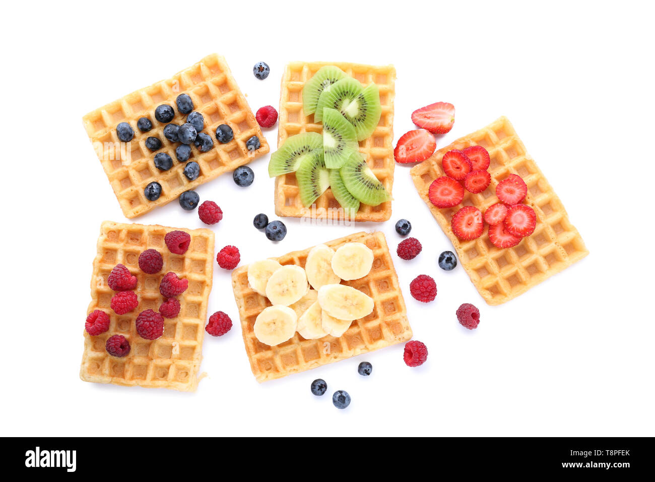 Delicious waffles with fruits and berries on white background - Stock Image