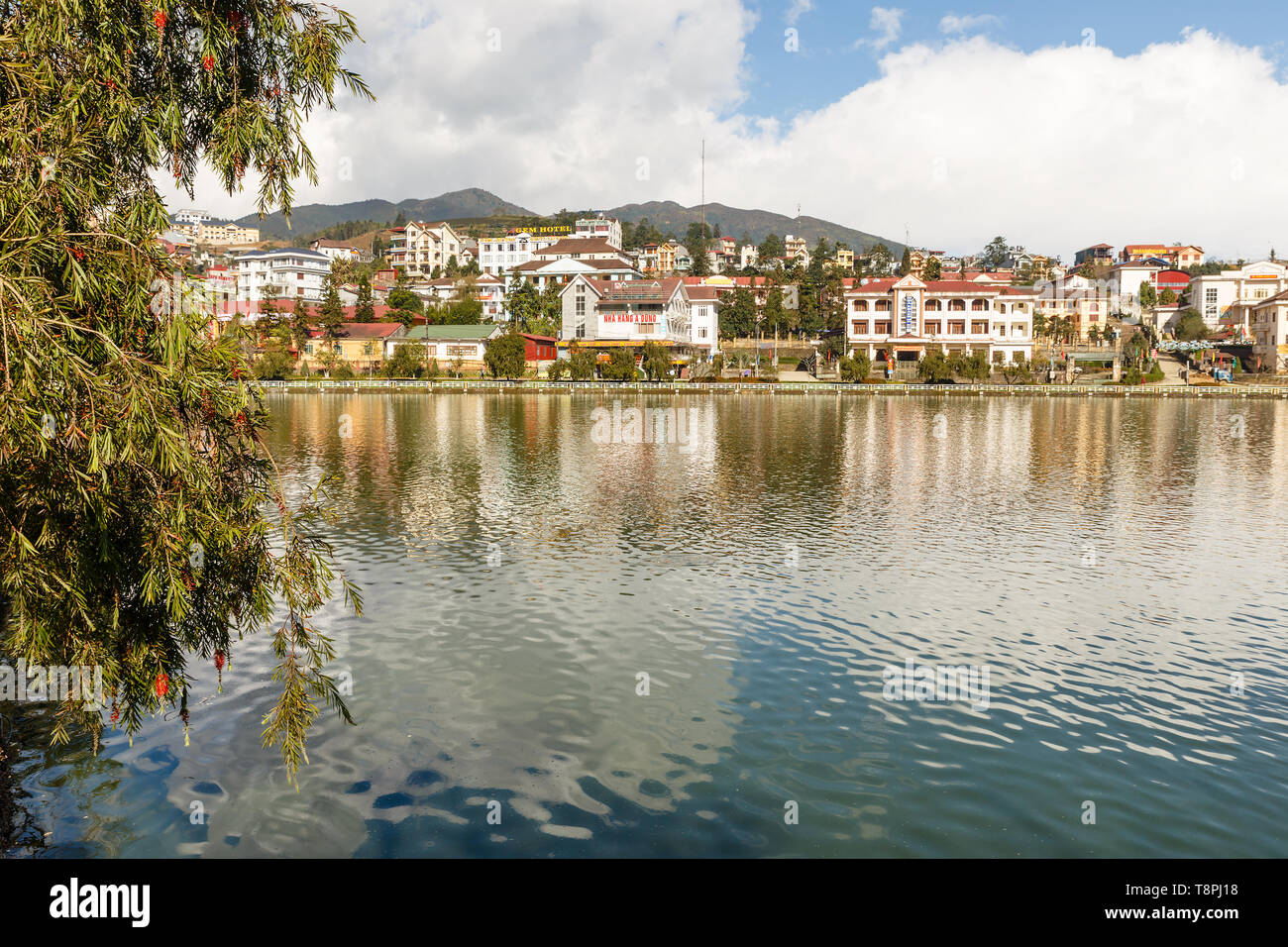 Sapa, Vietnam - November 20, 2018: View of the city of Sapa. Pond in the park in the foreground. - Stock Image