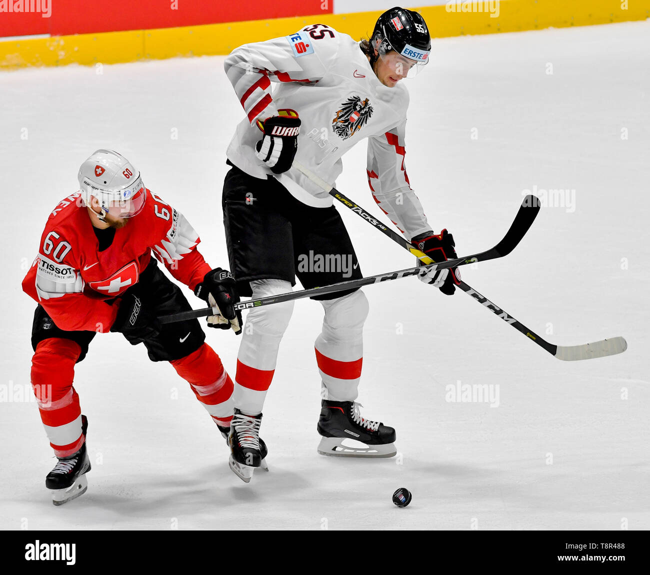 Bratislava, Slovakia. 14th May, 2019. L-R TRISTAN SCHERWEY (SUI) and RAPHAEL WOLF (AUT) in action during the match Switzerland against Austria at the 2019 IIHF World Championship in Bratislava, Slovakia, on May 14, 2019. Credit: Vit Simanek/CTK Photo/Alamy Live News Stock Photo