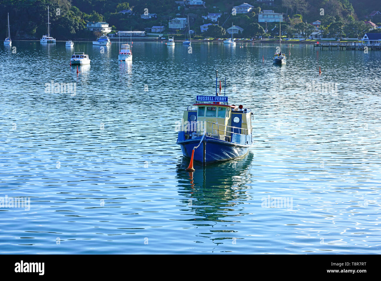 RUSSELL, NEW ZEALAND -29 JUL 2018- View of the Russell ferry in the Bay of Islands in Russell (Kororareka), the first permanent European settlement an - Stock Image
