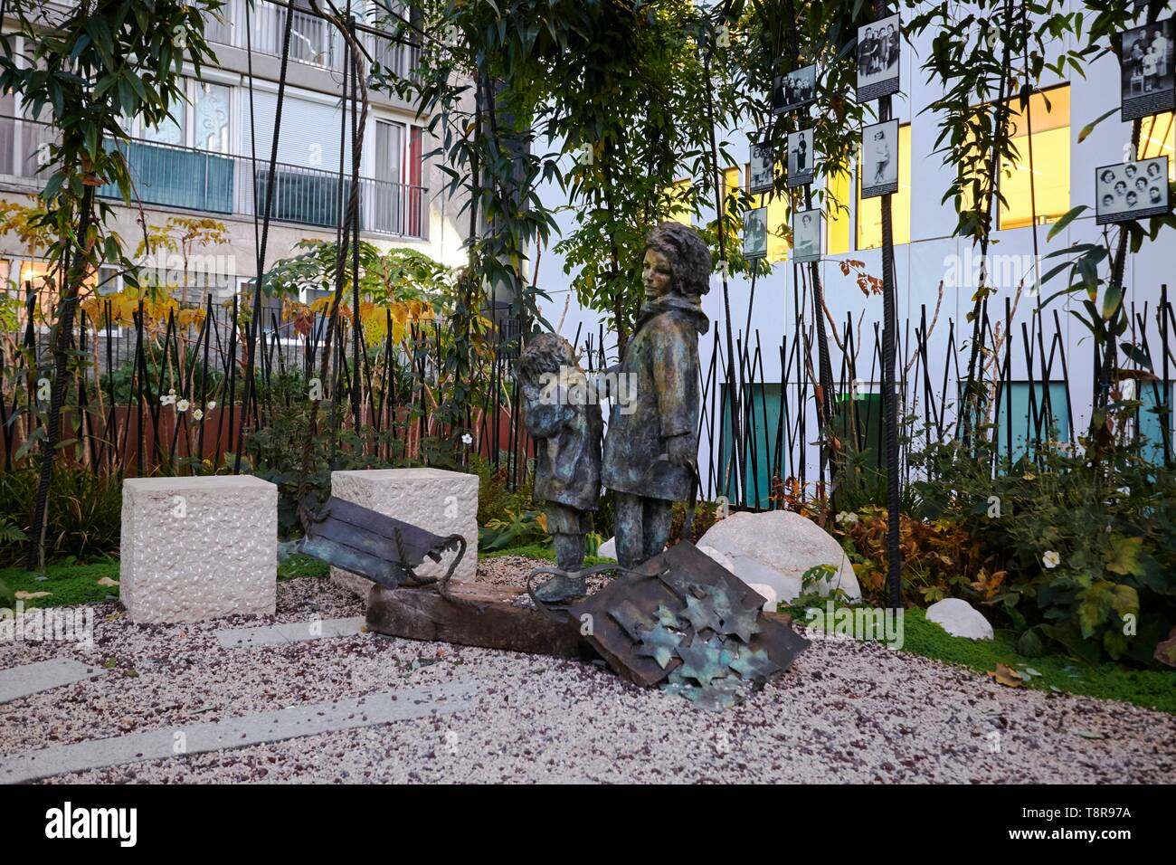 France, Paris, Grenelle district, rue Nelaton, Memorial Garden of the Children's Vel'd'Hiv, on the site of the former Velodrome d'Hiver, in memory of the raid on 16 and 17 July 1942, the largest arrest of Jews in France during World War II - Stock Image