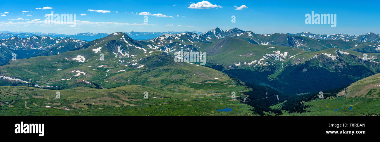 Spring at Top of Colorado Rockies - Panorama of rolling high mountains of Front Range of Rocky Mountains, looking west from summit of Mount Bierstadt. - Stock Image
