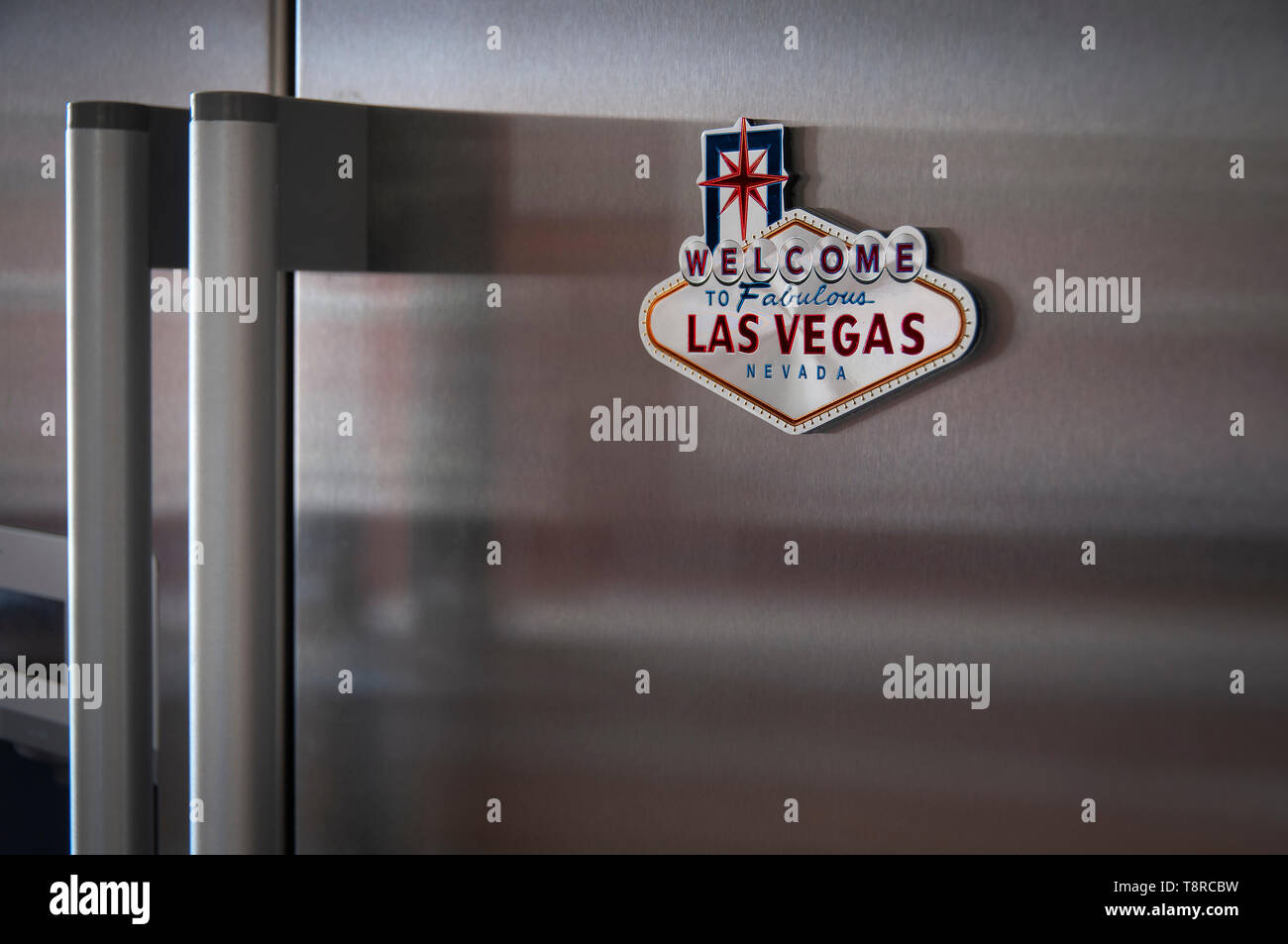 Las Vegas Fridge Magnet attached to a modern stainless steel fridge - Stock Image