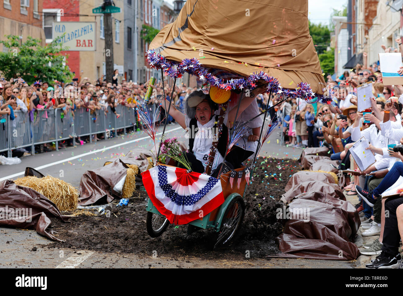 participants-near-the-finish-of-an-obstacle-course-as-their-art-bike-collapses-underneath-them-the-2019-kensington-kinetic-sculpture-derby-in-philadel-T8RE6D.jpg