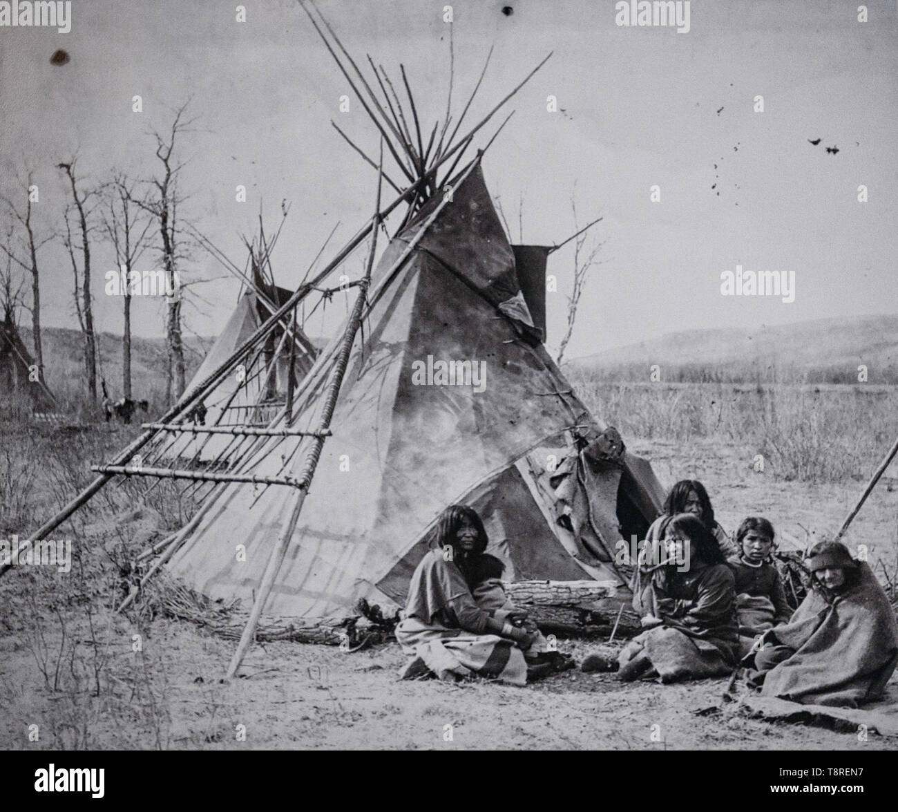 Vintage photo of a Tsuut'ina family in front of their teepee. Southern Alberta Canada circa 1886 - 1890 - Stock Image