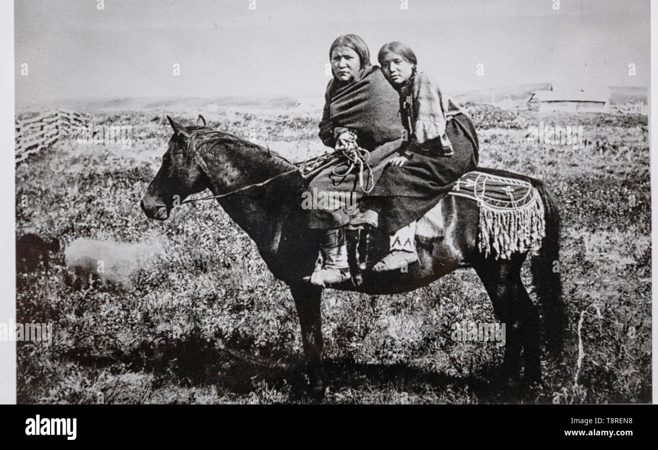 Vintage photo of Tsuut'ina women on horseback. Southern Alberta Canada 1887 - Stock Image