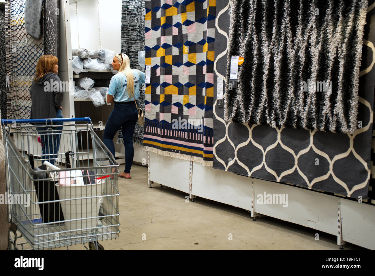 New Haven, CT USA. Sept 2018. Two women talking and shopping for designer carpets and rugs here at the world popular IKEA. - Stock Image