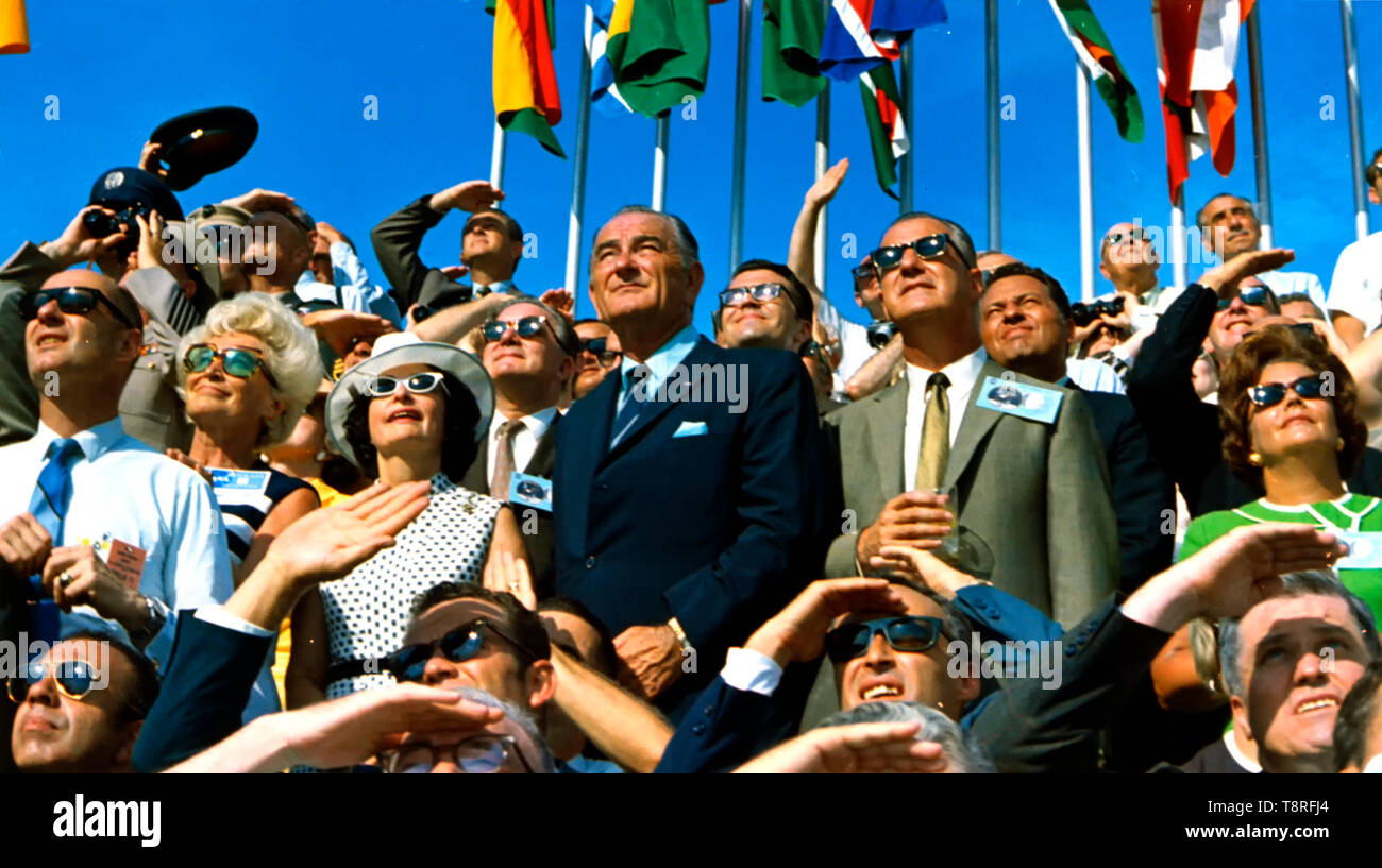 Former President Lyndon B. Johnson (on the left, without sunglasses) and Vice President Spiro Agnew (right, center) view the liftoff of Apollo 11 from pad 39A at Kennedy Space Center at 9:32 am EDT on July 16, 1969. July 16, 1969 - Stock Image