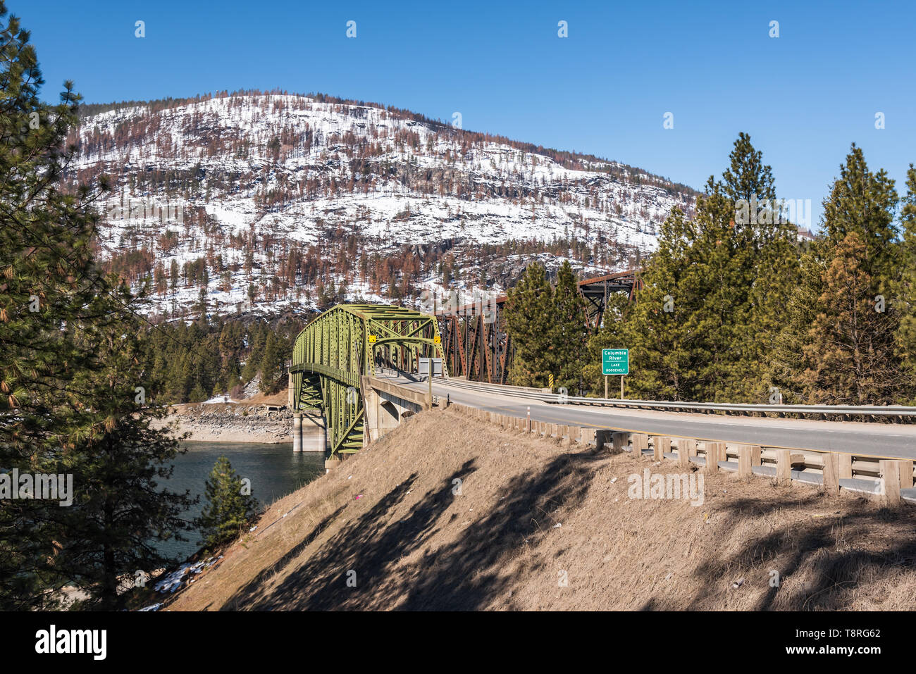 State Highway 20, US Highway 395 and the railroad cross Lake Roosevelt at Kettle Falls, Washington on Steel Truss Bridges in the early spring Stock Photo