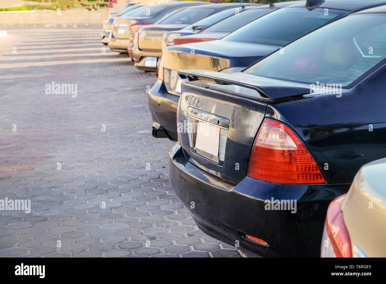 Row of parked cars on city street - Stock Image