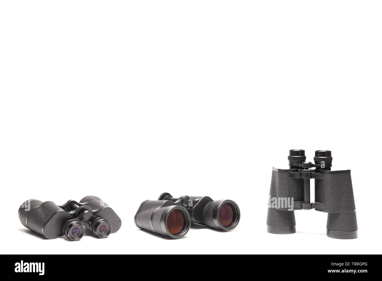 Three angles of vintage binoculars isolated on white background with texting space, travelling concept. - Stock Image