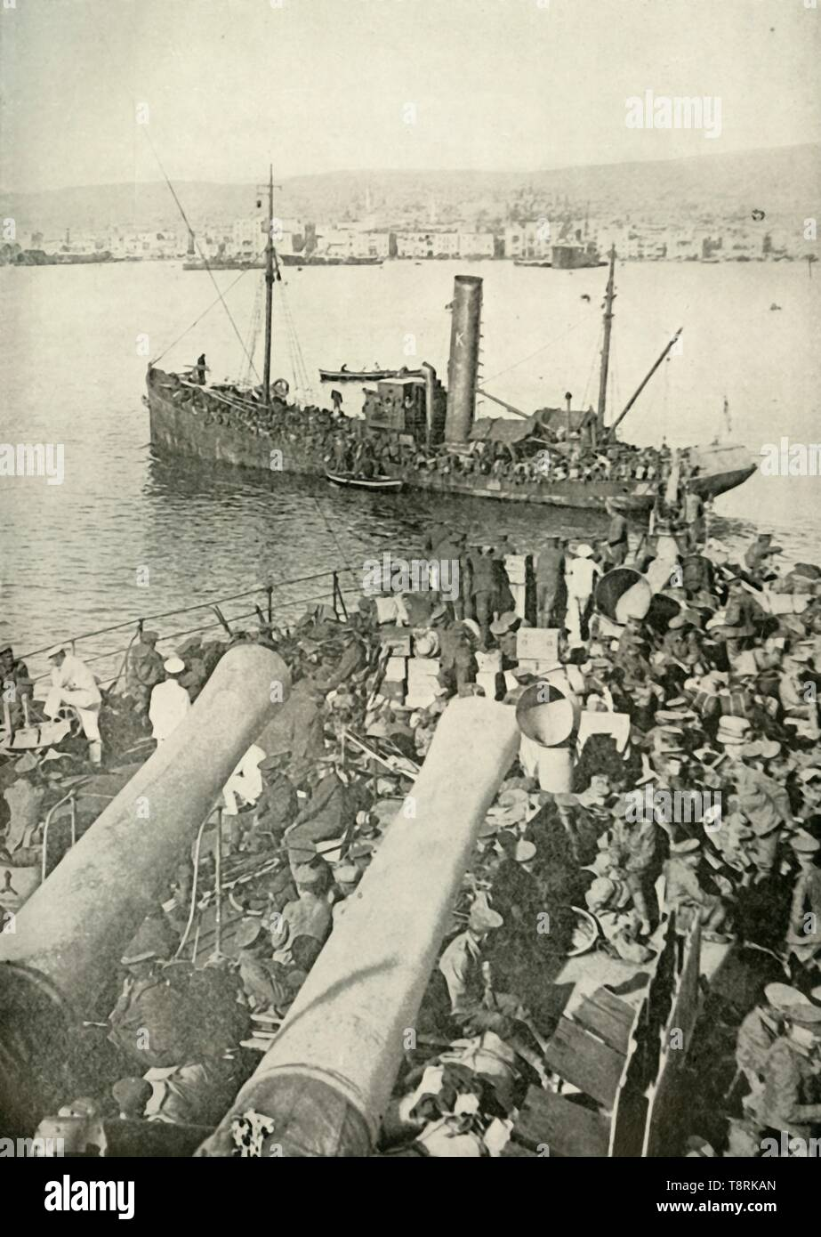 "'Landing of the British Troops at Salonika', (1919). Scene from the First World War, 1914-1919: 'Many of the troops evacuated from Gallipoli were transferred to Salonika [Thessaloniki in Greece], and with this transference a new phase of the war began. It marked the entry of the British troops into the Balkan theatre of war.' Between 1915 and 1918, British troops were part of an Allied force fighting against the Bulgarians and their allies in the Balkans. From ""The History of the Great European War: its causes and effects"", Vol. V, by W. Stanley Macbean Knight. [Caxton Pulishing Comp - Stock Image"