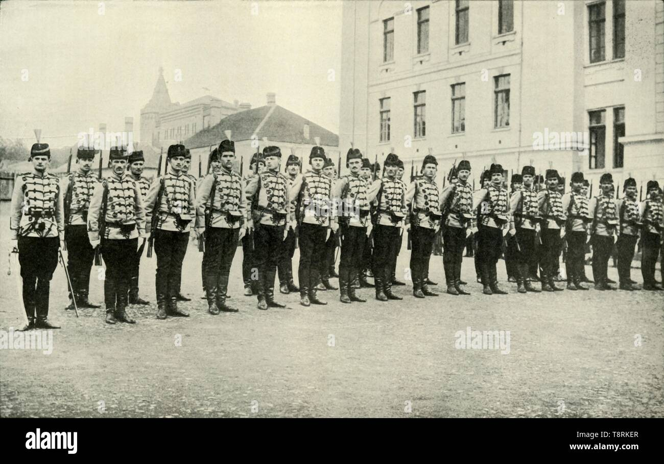 """'Servian Cavalry on Parade', (1919). Scene from the First World War, 1914-1919: 'The Servians [Serbians] are by no means the cut-throat barbarians they are commonly conceived to be; they have fine soldierly qualities - many of them are cultured and accomplished to a degree.' From """"The History of the Great European War: its causes and effects"""", Vol. I, by W. Stanley Macbean Knight. [Caxton Pulishing Company, Limited, London, 1919] - Stock Image"""