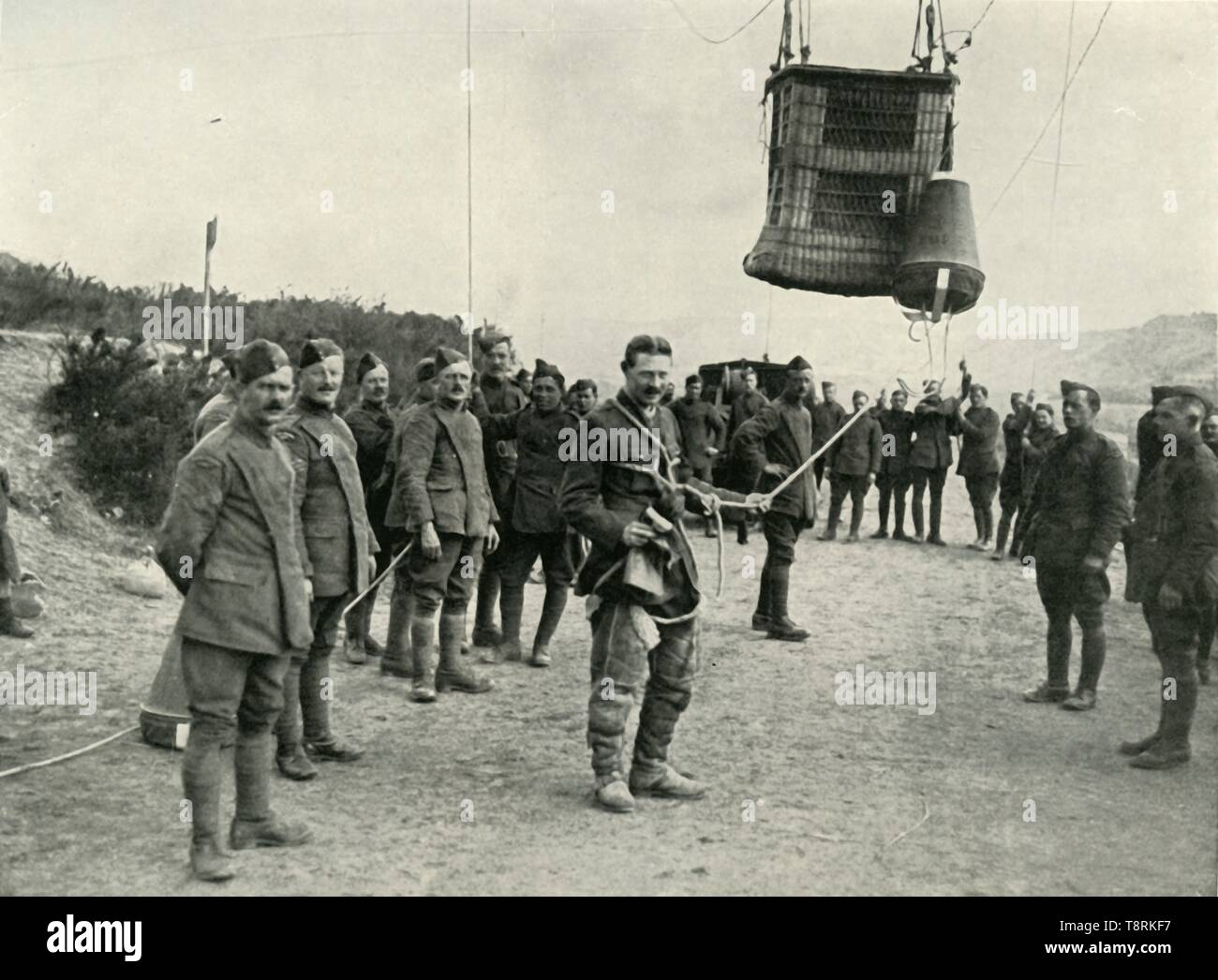 "'Royal Field Artillery Kite Balloons Were The Eyes of Our Guns in France', (1919). Scene from the First World War, 1914-1919: 'The observers were highly trained men, and when their balloons were shelled or attacked by enemy aircraft they were forced to make rapid descents in parachutes. The observers were always connected with their parachutes.' From ""The History of the Great European War: its causes and effects"", Vol. VIII, by W. Stanley Macbean Knight. [Caxton Pulishing Company, Limited, London, 1919] - Stock Image"
