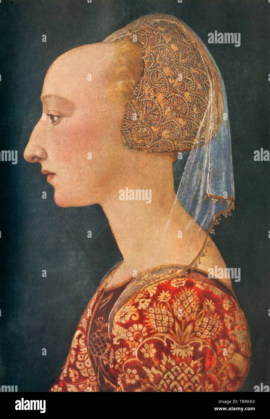 """'Portrait of a Lady in Red', 1460-1470, (1934). Portrait of an unknown woman in an embroidered cap decorated with pearls. Her high forehead, achieved by shaving or plucking, is emphasised by the prophile view. Painting originally acquired as a portrait of Isotta da Rimini by Piero della Francesca but probably by a Florentine artist, in the National Gallery in London. From """"The Connoisseur"""", Vol 93, No 389, January 1934. [The Connoisseur Ltd., London, 1934] - Stock Image"""