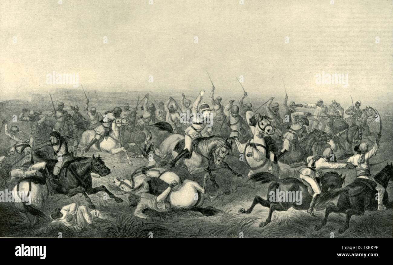 """'Charge of Hodson's Horse at Rhotuck', 1857, (1901). British and Indian forces at the Battle of Rohtak. Hodson's Horse was a unit of loyalist Indian cavalry raised by Brevet Major William Stephen Raikes Hodson during the Indian Mutiny (1857-1859). From """"The Life and Deeds of Earl Roberts, Vol. I. - To The End of the Indian Mutiny"""", by J. Maclaren Cobban. [T. C. & E. C. Jack, Edinburgh, 1901] - Stock Image"""