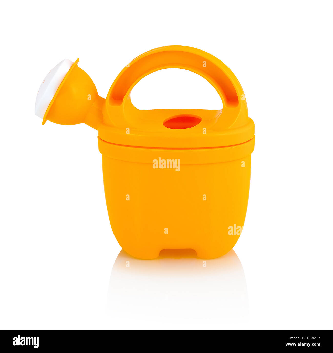 Children's small plastic watering can isolated on the white background with shadow reflection. Watering-can toy for watering plants and flowers, for p - Stock Image