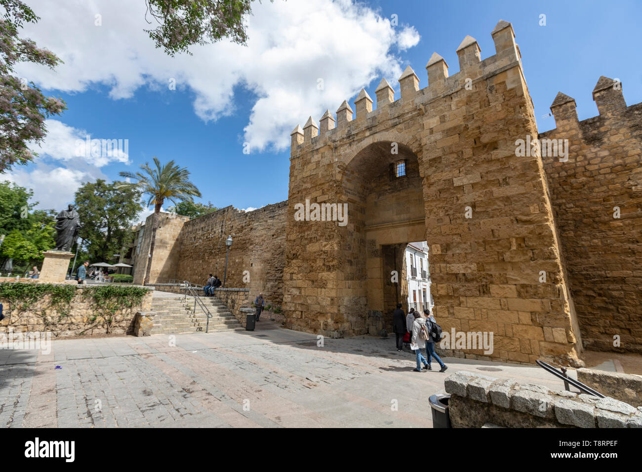 The statue of philosopher Lucius Annaeus Seneca the Younger by Amadeo Ruiz Olmos and Puerta de Almodóvar, Roman walls, Cordoba, Andalusia, Spain - Stock Image