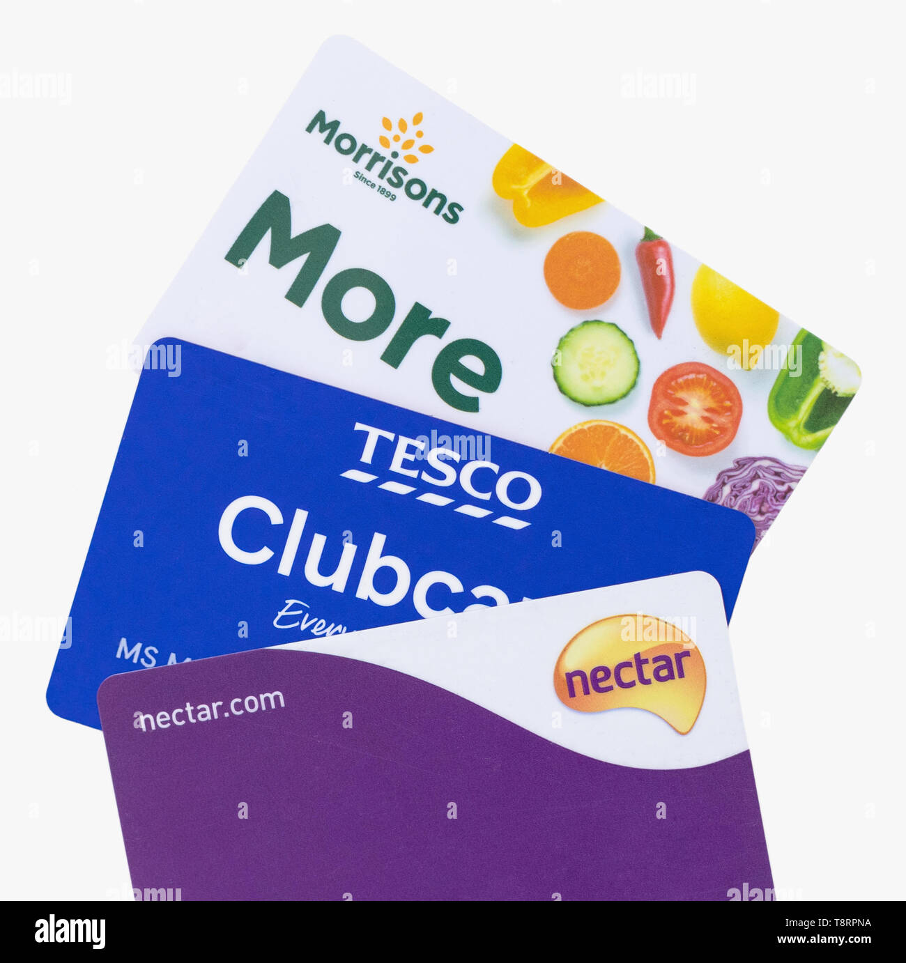 London, UK - 14th May 2019 - Sainsburys Nectar card, Tesco clubcard and Morrisons More cards isolated on a white background - Stock Image