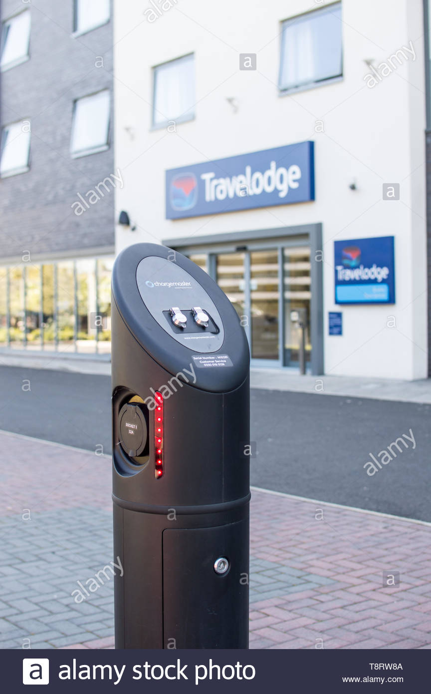 An electric recharge point in a hotel car park - Stock Image