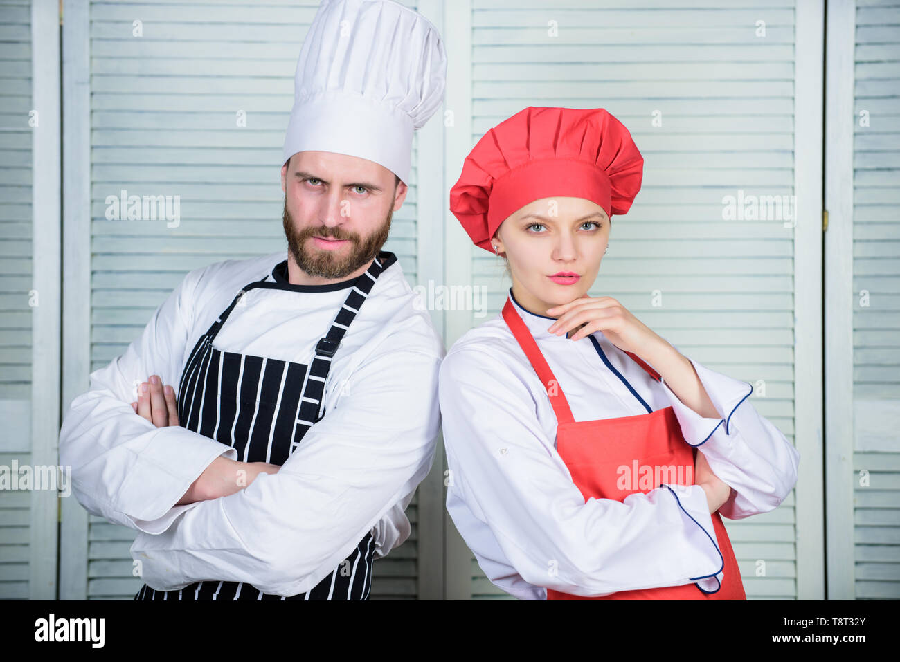 Delicious family dinner. Reasons couples cooking together. Cooking with your spouse can strengthen relationships. Teamwork in kitchen. Woman and bearded man culinary partners. Couple cooking dinner. - Stock Image