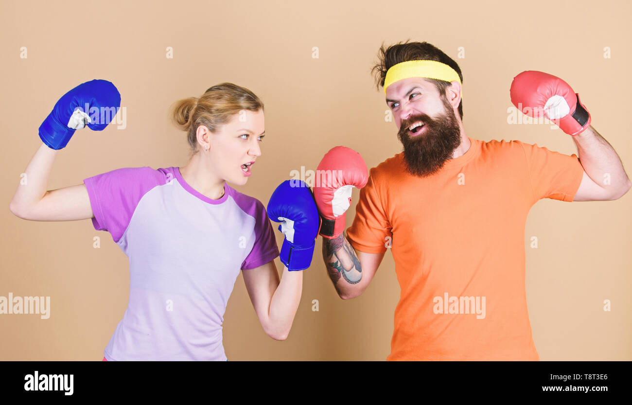 Pain is temporary, Pride is forever. training with coach. Happy woman and bearded man workout in gym. sportswear. Fight. knockout and energy. couple training in boxing gloves. punching, sport Success. - Stock Image