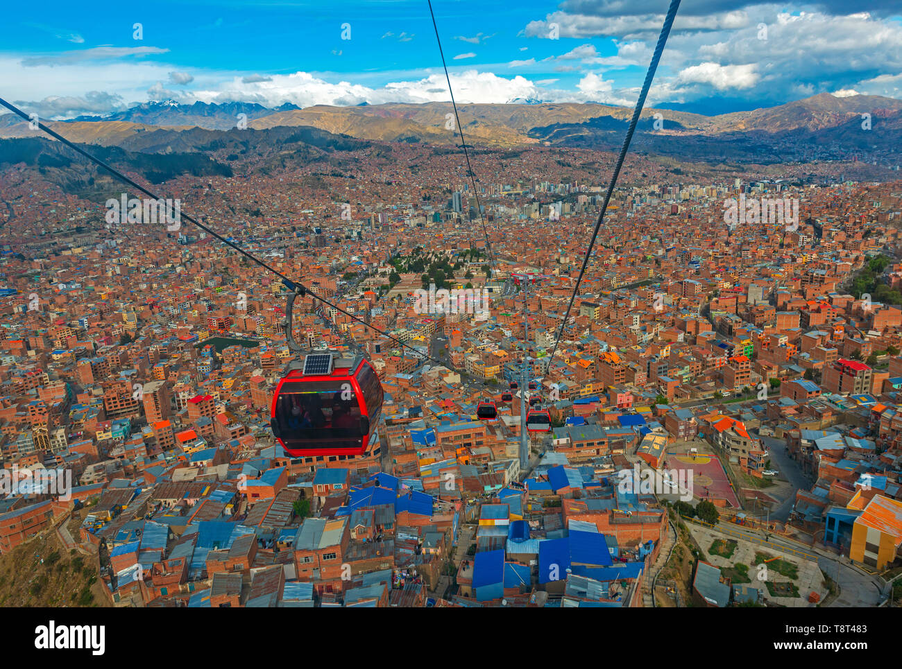 Cityscape of La Paz city and the new public transport system of Cable Cars named Teleferico, the snowcapped Andes mountain peaks in the back, Bolivia. Stock Photo