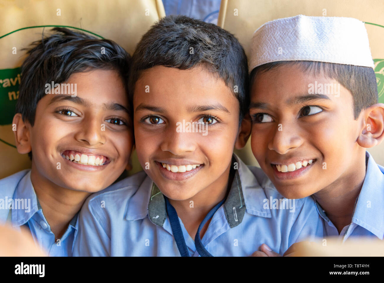 Horizontal view of children on a school bus in Munnar, India. - Stock Image