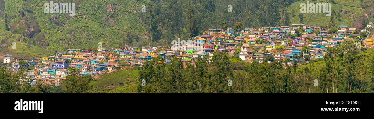 Horizontal panoramic view of the colourful New Colony in Munnar, India. Stock Photo