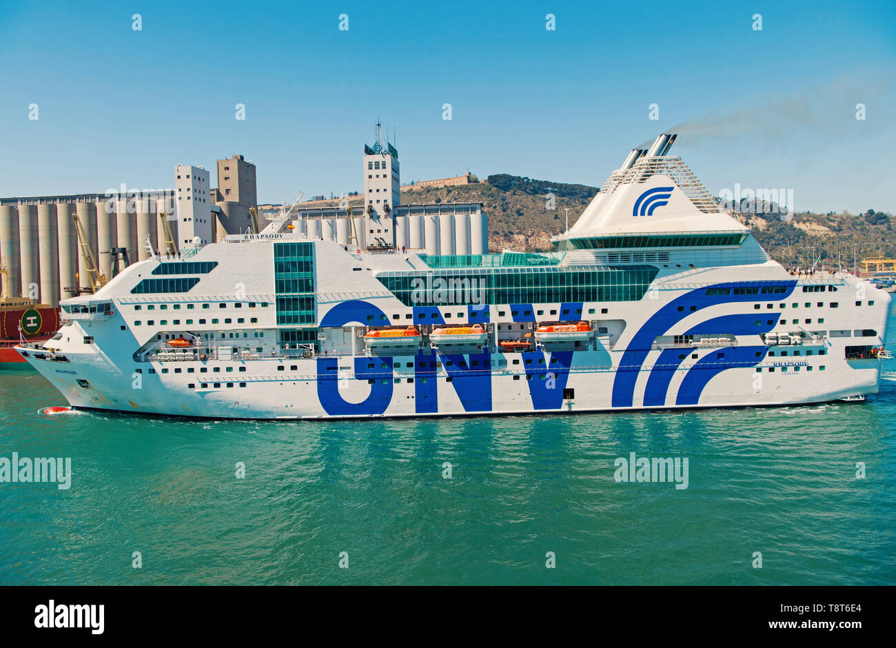 Barcelona, Spain - March 30, 2016: passenger vessel GNV Rhapsody Genova in sea port. Cruise destination and vessel trip. Summer vacation and wanderlust. vessel trip discovery. Travel by sea vessel. - Stock Image