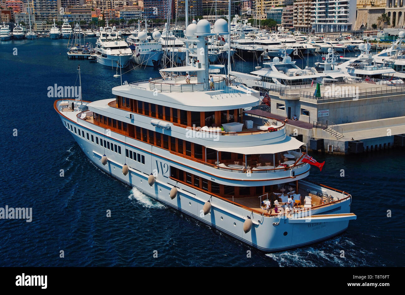 Monte Carlo, Monaco - December 08, 2009: W2 Wedge Too yacht go into sea port. Yacht club in harbor. Sea adventure and boat trips. Pleasure and sport. Vacation and summer wanderlust. - Stock Image