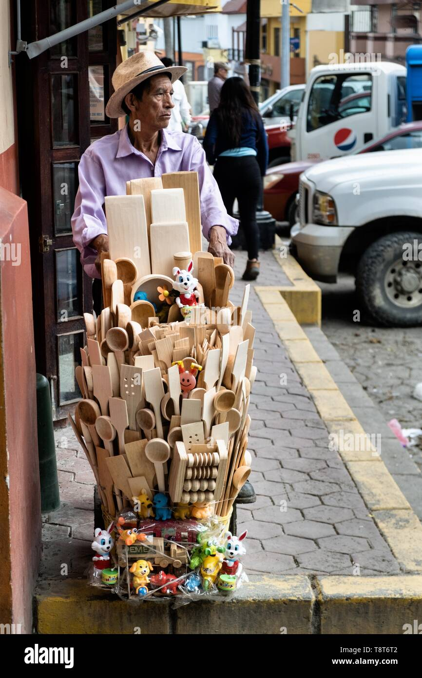 A street vendor sells hand carved wooden kitchen implements in Papantla, Veracruz, Mexico. - Stock Image