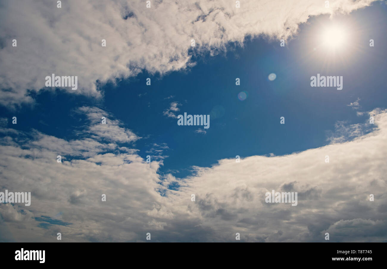 Blue sky bright sun between white clouds. Weather forecast tropic island st, johns antigua. Heat tropical climate. Tropical hot weather. Put sunscreen before sun tanning beach. Protect skin sun tan. - Stock Image