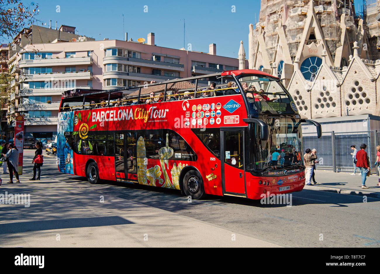 Barcelona, Spain - March 30, 2016: Barcelona city tour bus on street. Sightseeing and travelling. Transport for trip around Barcelona. Summer vacation in Barcelona. - Stock Image