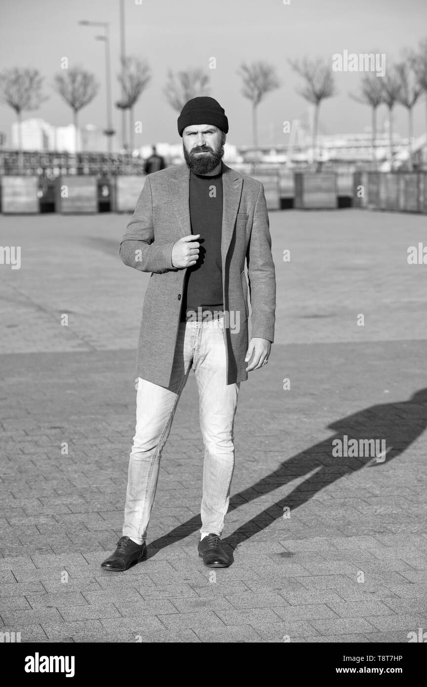 Hipster outfit. Stylish casual outfit for fall and winter season. Menswear and male fashion concept. Man bearded hipster stylish fashionable coat. Comfortable and cool. Masculine casual outfit. - Stock Image