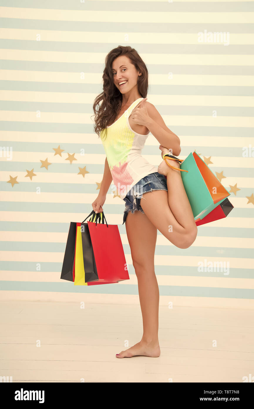 Too many packages to hold by only hand. Woman carries bunch shopping bags striped background. Finally bought favorite brand. Tips shop sales. Girl satisfied shopping. Profitable purchase black friday. - Stock Image