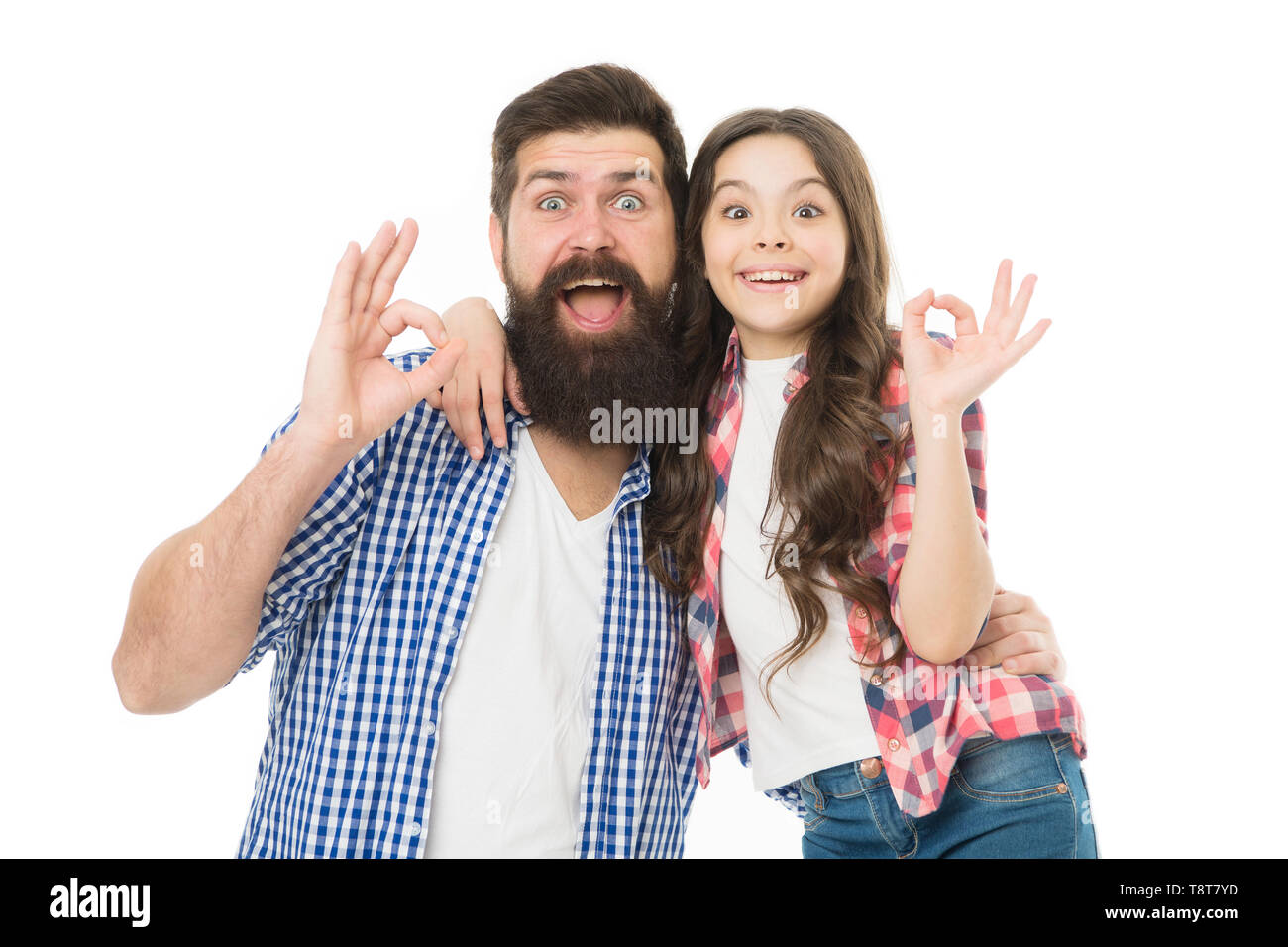 Casual and informal. Bearded man and cute girl in casual outfit gesturing ok. Happy father and small child in casual style. Father and little daughter in casual wear smiling with ok gesture. - Stock Image