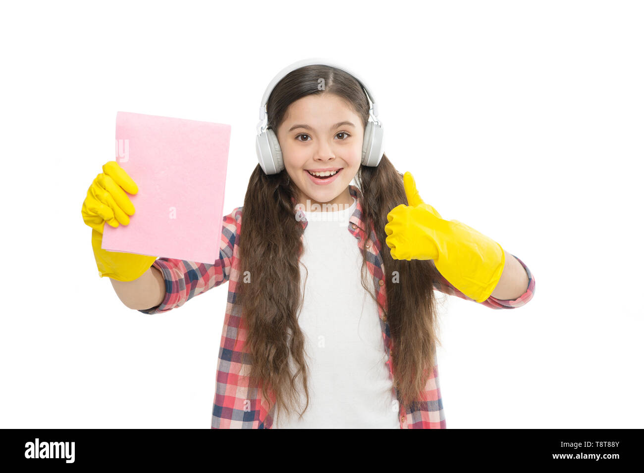 Cleaning supplies. Anti allergen cleaning products. Let music move you. Girl headphones and gloves cleaning. Make household more joyful. Have fun. Cleaning worries away. Everything in its place. - Stock Image