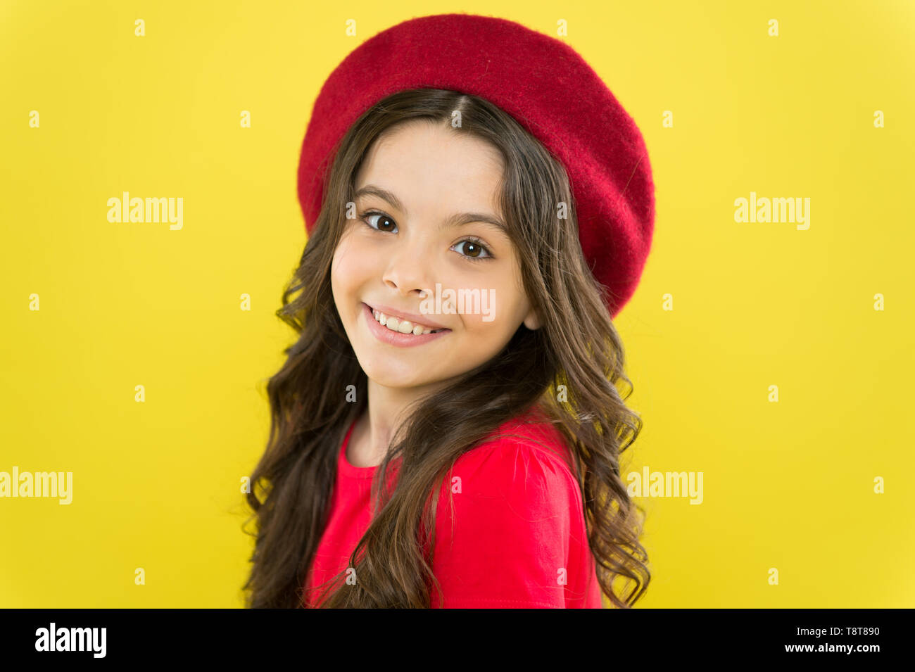 21a69726e Kid girl long healthy shiny hair wear red hat. Little girl with long hair.