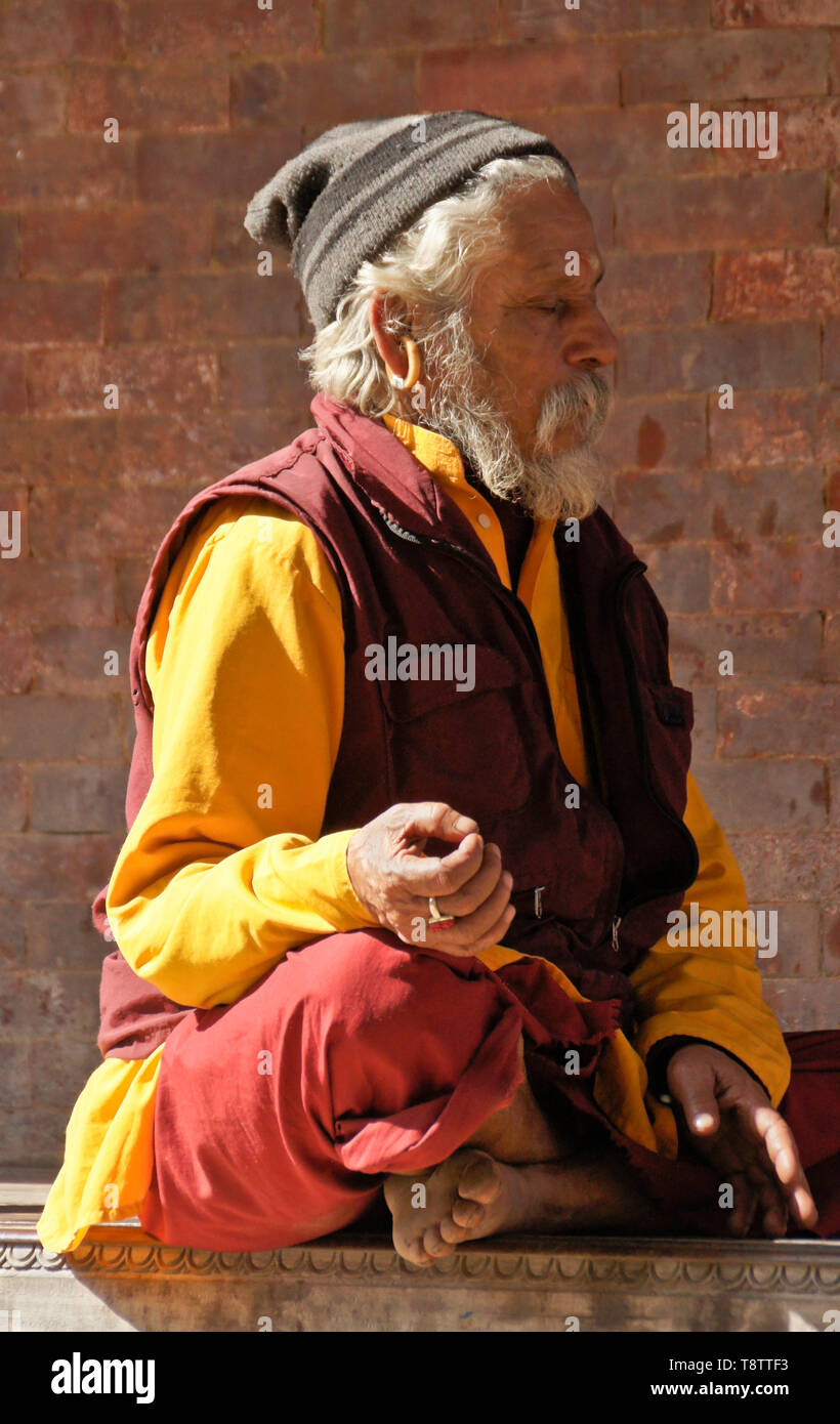 Hindu sadhu (holy man) meditating in Durbar Square, Kathmandu, Nepal Stock Photo