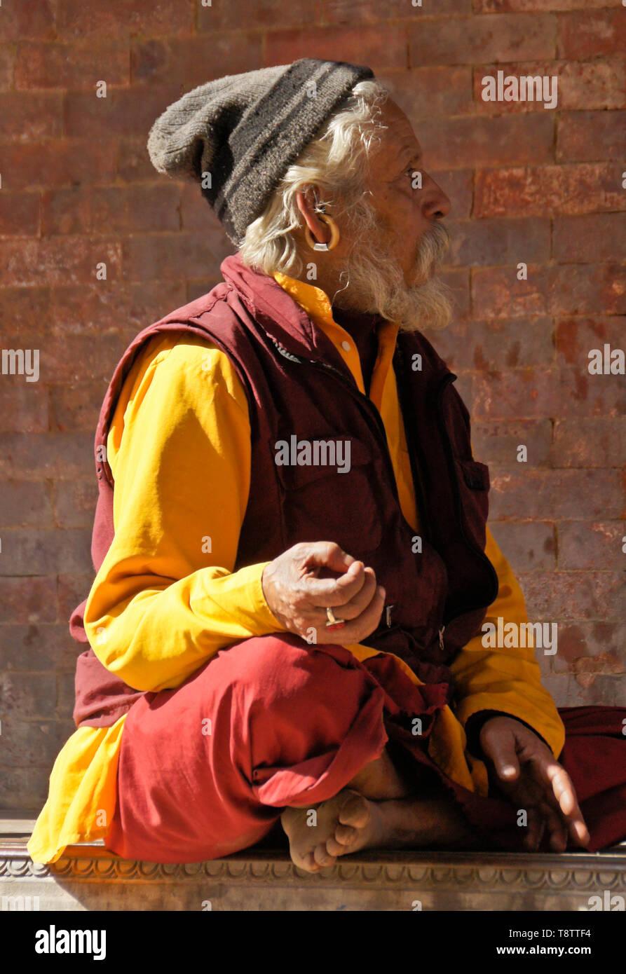 Hindu sadhu (holy man) meditating in Durbar Square, Kathmandu, Nepal - Stock Image