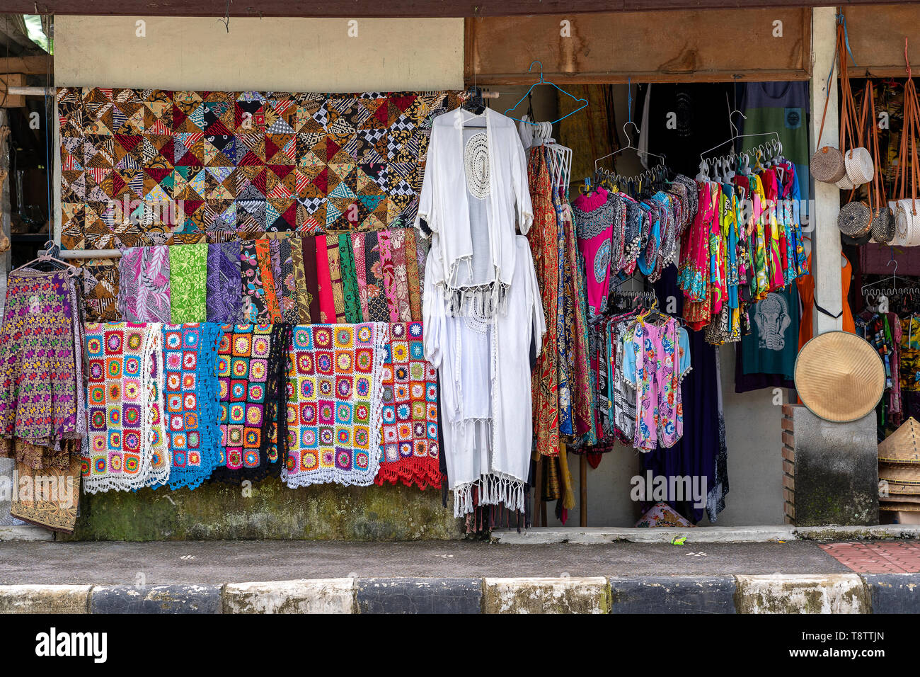Street clothes shop and souvenirs, close up. Ubud, Island Bali, Indonesia. Indonesian street market - Stock Image