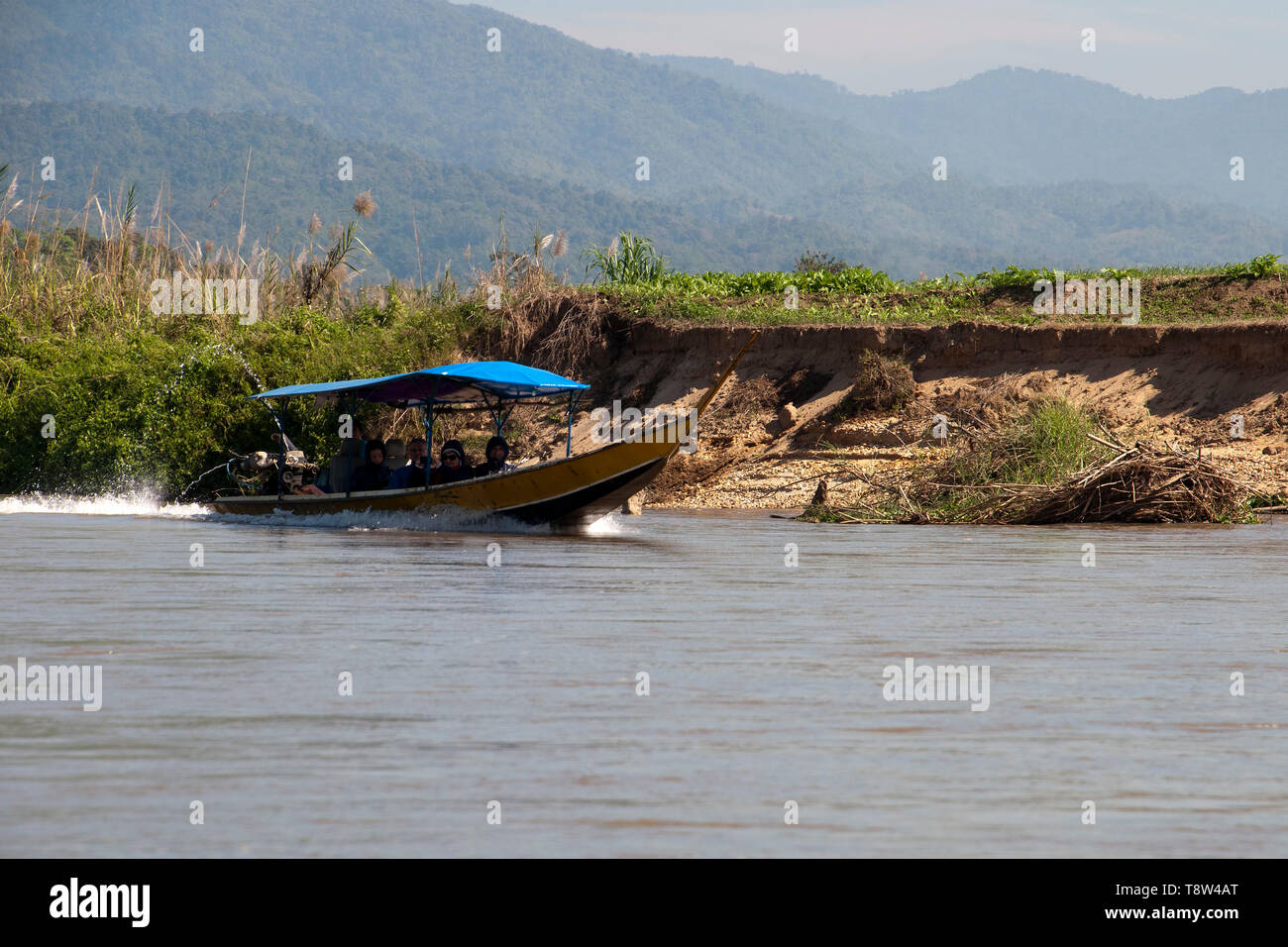 Kok River Thailand Jan 4 2019, long boat with passengers travelling up river - Stock Image