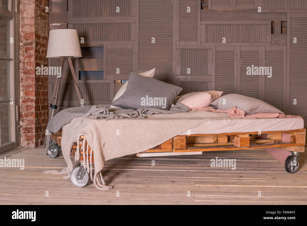 Loft Apartment Interior Minimalist Interior With Simple Wooden Bed Lamp Big Window Stylish Bedroom In Loft Style Pastel Colors Copy Space Stock Photo Alamy