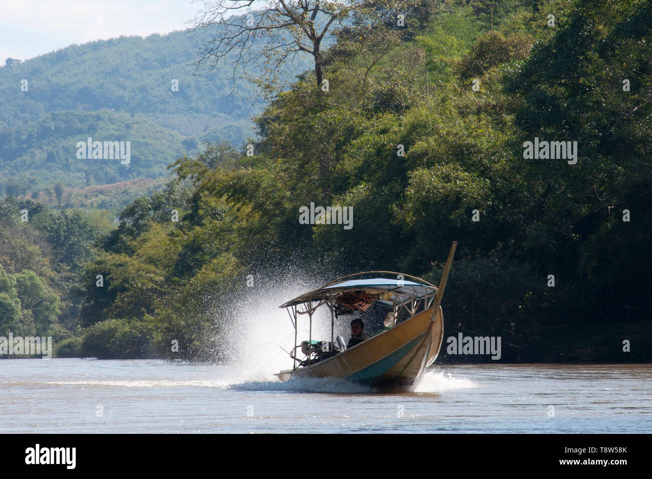 Kok River Thailand Jan 4 2019, long boat travelling up river - Stock Image