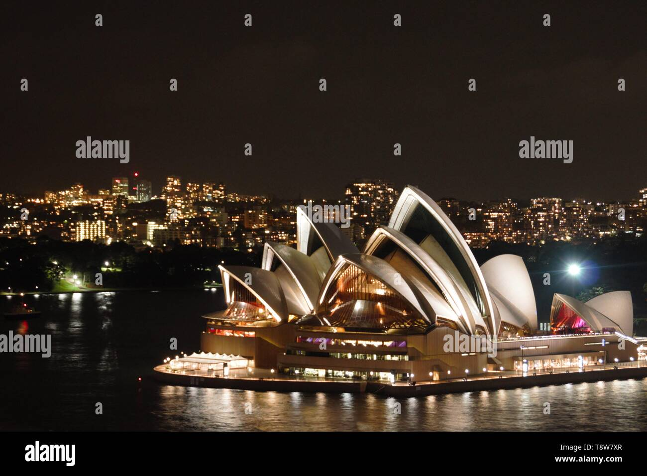Sydney opera house by night from the harbour bridge - Stock Image