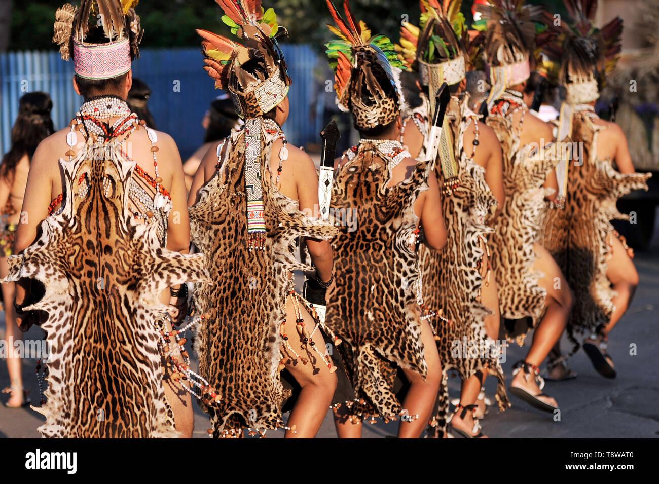 Men in traditional dress made of jaguar skin - Stock Image